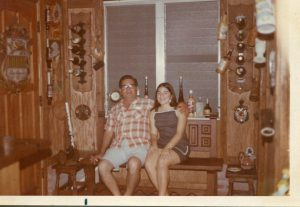Benito Permuy with daughter Maria Lourdes (Veras, Herrera) in the bar at home. Hialeah, Florida