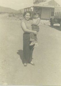 Carmen Canete Permuy carries her young daughter, Lupe Permuy Leyva in Cuba.