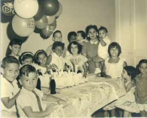 Birthday Party in Cuba before Castro. Pictured here: Carmen Permuy carries little Benny Permuy, Lupe and Maria de Lourdes to the right.