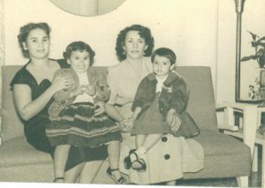 Lupe Permuy Leyva sitting on mother's lap, Carmen Permuy, in Cuba before Castro